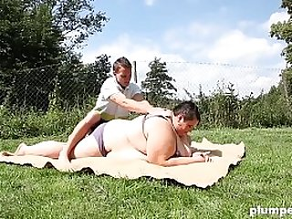 BBW sits on young boy face outdoors