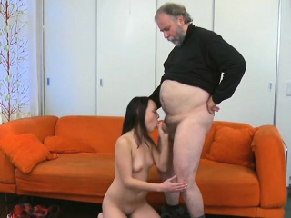 Old dude stuffs mouth of a young sweetheart with his cock