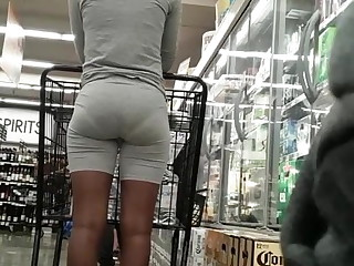 Candid slim ebony bubble butt, VPL posing in line.